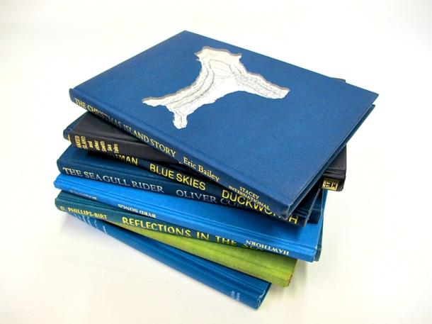 Nicholas Jones, a stack of modified books